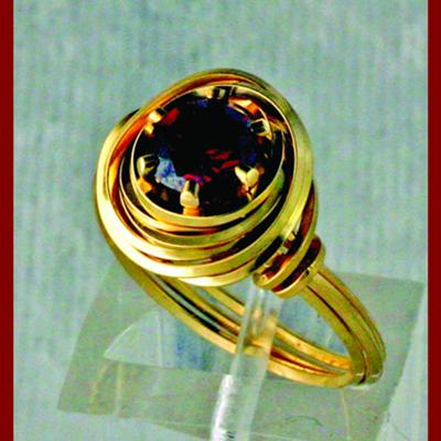 Birds Nest Ring With Garnet