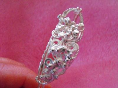 An impressive silver filigree bracelet, by Tracey.